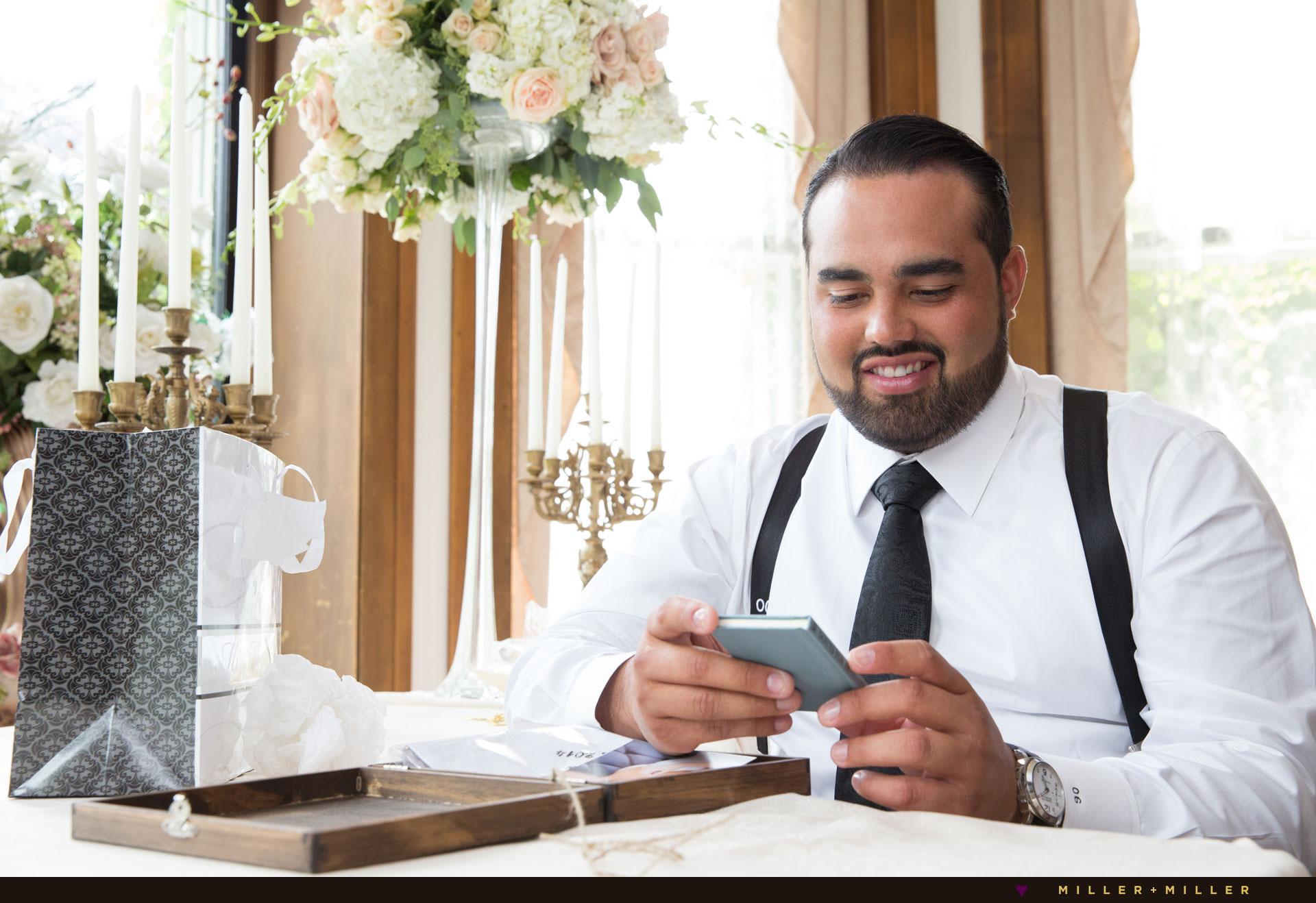 groom-opens-bride-gift
